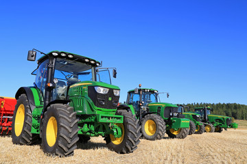 Line up of John Deere Agricultural Tractors. Illustrative Editorial Content.
