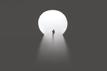 man walking toward keyhole light door