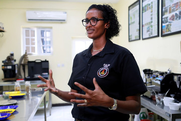 Dr. Nasra Ali, Founder of Kaldi Coffee limited speaks to Reuters during an interview at the quality control laboratory of Kaldi Africa Coffee shop in Lagos