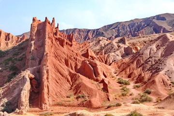 Foto op Aluminium Koraal red cliffs in the canyon fairy tale, lake issycula, Kyrgyzia