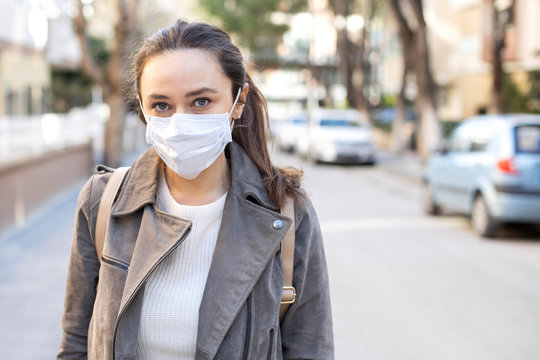 Young woman in medical face protection mask