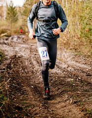 Fototapete - male runner run on muddy trail autumn marathon race