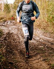 Wall Mural - male runner run on muddy trail autumn marathon race