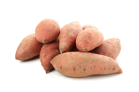 Heap of sweet potato isolated on white background