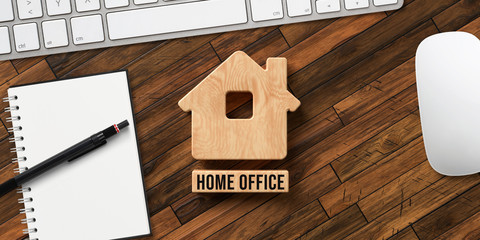 house symbol and wooden blocks with text HOME OFFICE on wooden background