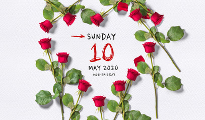 calendar with Mother's Day 2020 surrounded by roses in a heart shape on paper background