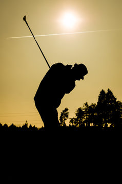 Silhouette Man Playing Golf Against Clear Sky