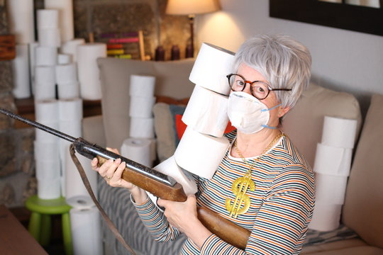 Greedy senior woman stocking up toilet paper at home