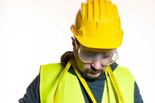 Construction Worker Wearing Hardhat Against White Background