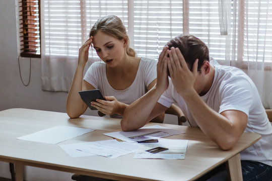 Stressed caucacian couple conflict of credit card bills or debt of over expense in shopping. Lover financial risk or crisis and bad habits of shopaholic. Lack of money discipline, planning and advisor