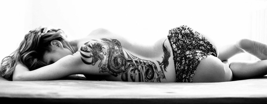 Panoramic Shot Of Sexy Semi-naked Beautiful Woman Lying On Bed At Home