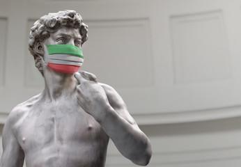 Italy coronavirus crisis. 3D sculpture of David in medical mask colored in italian flag colors. Pathogen coronavirus flu covid-19 outbrake in Italy, corona virus pandemic quarantine background concept Fotomurales