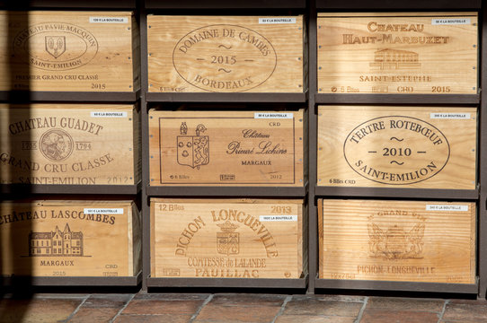 Display of wooden wine cases in Saint-Emilion, Gironde, France.  St Emilion is one of the principal red wine areas of Bordeaux and very popular tourist destination.