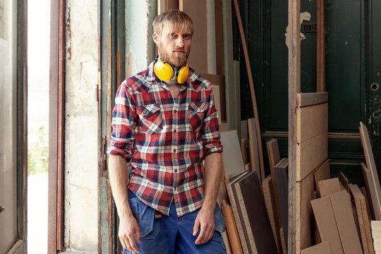 portrait of a workman carpenter in his workshop