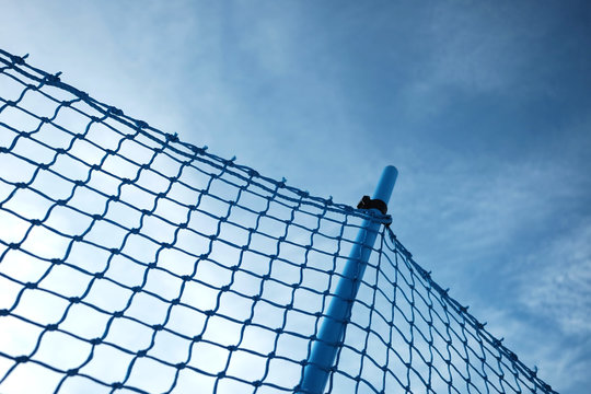 Blue plastic net and a blue sky