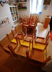 Upturned chairs are pictured at German-Italian language Kindergarten Asilo Italiano in Berlin