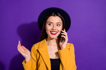 Fototapete - Portrait of positive cheerful girl enjoy travel trip speak with friends on cell phone wear yellow blazer shine headwear isolated over purple color background