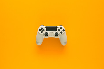 Stock photo of a gamepad on a yellow background
