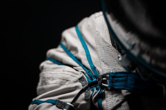 Space suit details. Close up on zip and buckle. White fabric, blue straps. Hightech concept for space travel and astronautical missions. Hightech concept, advanced research equipment.