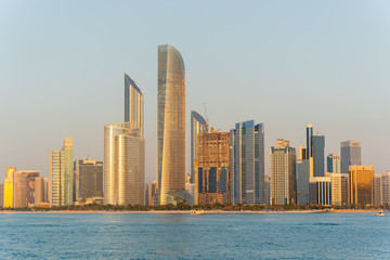 Canvas Prints Abu Dhabi Golden hour view of Abu Dhabi financial district skyline. Luxury lifestyle hotels and business of United Arab Emirates.