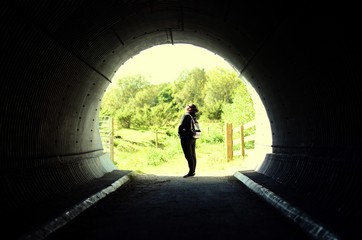 Papiers peints Tunnel Side View Of Woman Standing In Tunnel
