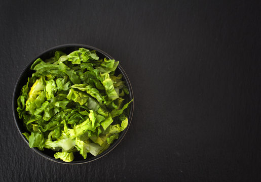 Shredded lettuce in a bowl