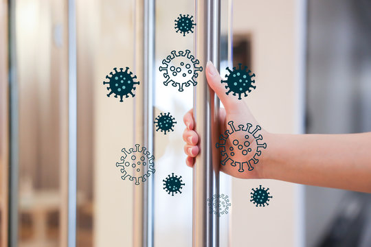 Woman Hand open the Office Glass Door