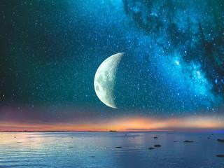 Starry night  moon on blue  sky at sea, sunset at  summer season , sea dark blue water  reflection...