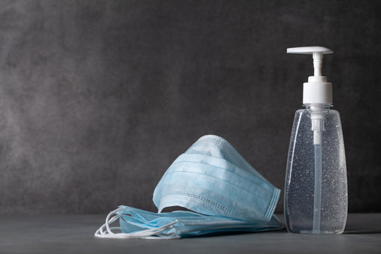 Sanitizer gel or antibacterial soap and face mask for coronavirus preventive measure