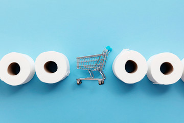 Photo sur Toile Nature Roll of white toilet paper with a shopping cart on a blue background