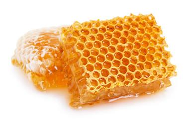 Fototapete - Honeycomb with honey on white background