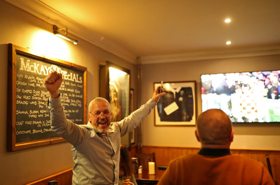 Punters watch the Cheltenham Gold Cup in a bar in Pitlochry