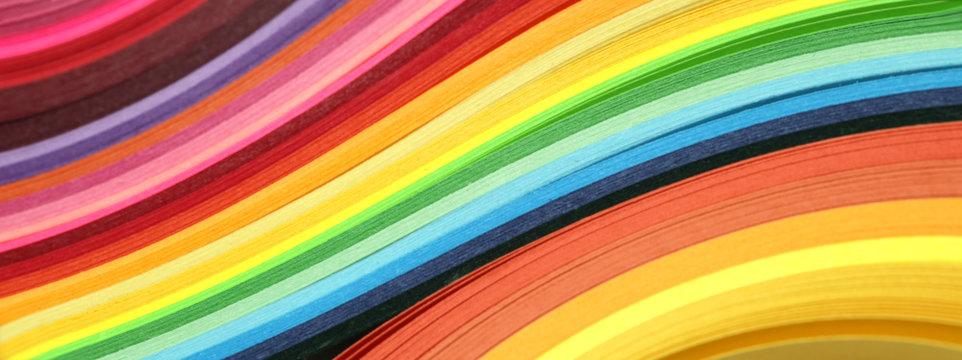 Abstract color rainbow strip curl line paper background.