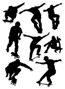 set of silhouettes of skateboarders vector