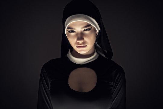 gloomy portrait of a young nun closeup