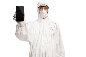 Man in a hazmat suit showing a mobile phone