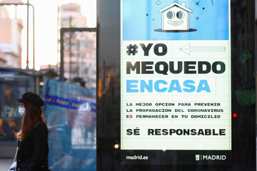 An ad, advising people to be responsible and stay home, is displayed at Gran Via avenue due to the coronavirus outbreak in central Madrid
