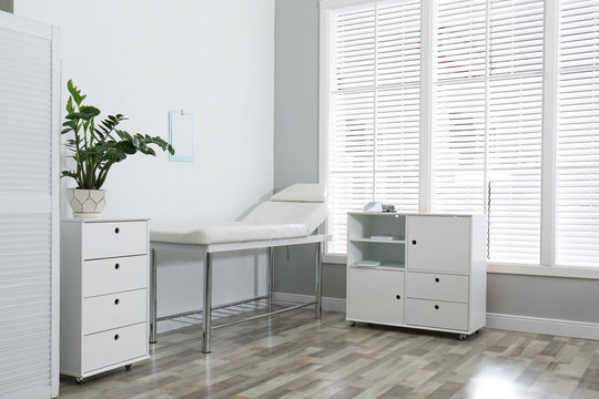 Modern medical office interior with examination table