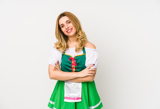 Young woman wearing a saint patricks day clothes isolated laughing and having fun.