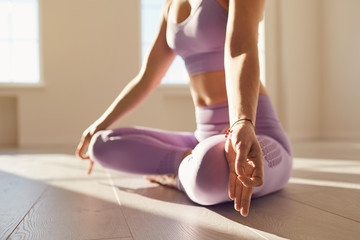 Calm woman meditates relax in lotus position in yoga class.