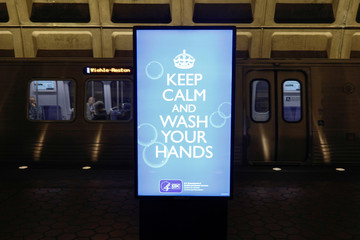 "An electronic sign displaying the message ""Keep Calm and Wash Your Hands"" is seen on display inside the Court House subway metro station, as Virginia Governor Northam declared a State of Emergency due to the COVID-19 Coronavirus pandemic, in the Court Hous"