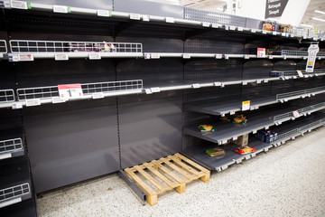 Espoo, Finland - 13 of march 2020: Empty shelves of supermarkets in Espoo, Finland. People stockpiling during Coronavirus pandemic