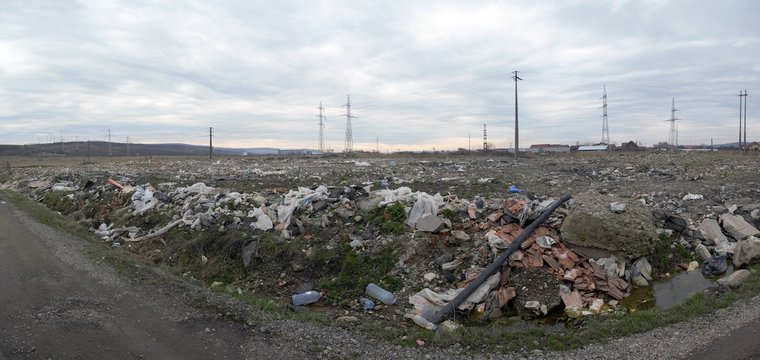 a field polluted with waste