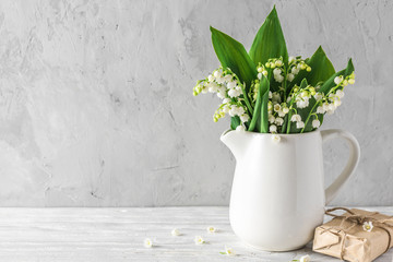 Wall Murals Lily of the valley Still life with a beautiful spring lily of the valley flowers and gift box on white background