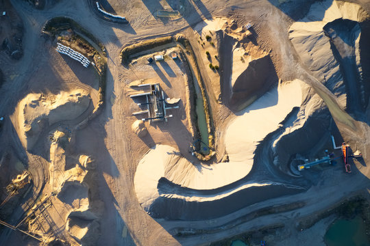 Quarry works industrial digging aerial view from above showing sand mound and hills
