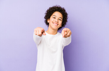 African american little boy isolated cheerful smiles pointing to front. Fotobehang