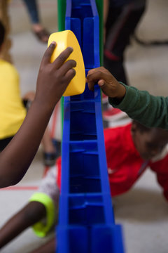 Kids playing huge jenga at a fundraising event