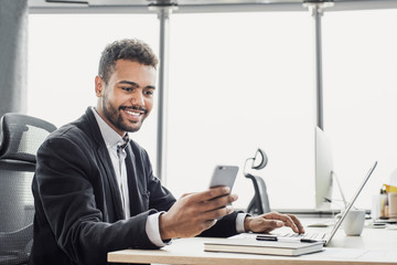 Businessman working on computer, Young man professional using laptop and smart phone in the office,...