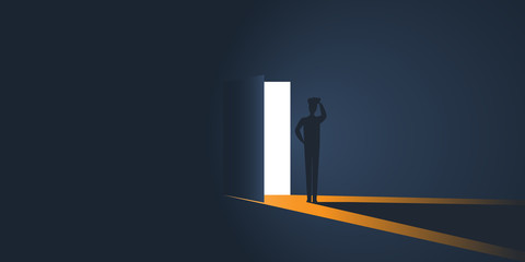 Standing Business Man in a Dark room, Open Door with Light Going Through It - New Possibilities, Hope Concept, Overcome Problems, Solution Finding