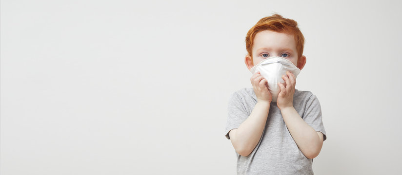 Little boy trying to stay healthy by wearing a mask to protect him against corona virus covid-19 / 2019-nCov